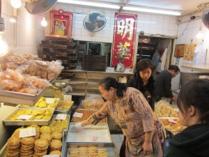 Choosing pastries at a local bakery in Hong Kong