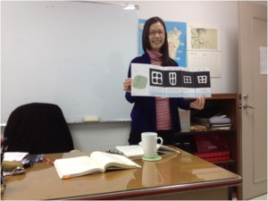 My teacher, Zhan Laoshi, showing the evolution of the Chinese word for _field_ over the years