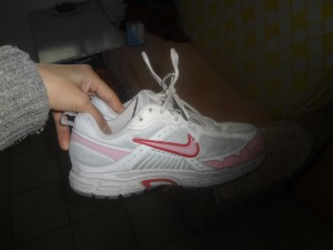 Pink and white Nike shoes Dama bought in Las Vegas