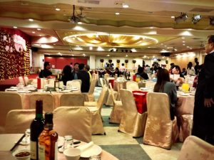A view of the banquet hall, with dozens of tables filled with hungry guests