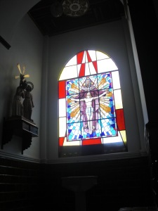 An image of Jesus on a stained glass window