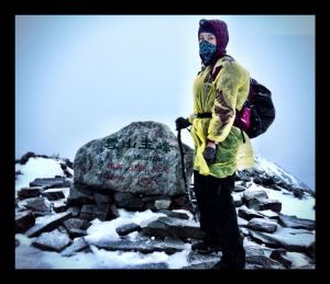 At the summit of Snow Mountain in Taiwan, after a long and exhausting climb
