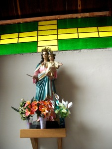Beautiful, hand-painted images of saints are essential to churches in Colombia