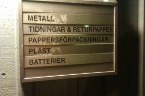The recycling room outside of my building, Rackarbergsgatan.  Note that there are places for metal, paper, cardboard, plastic, and batteries.