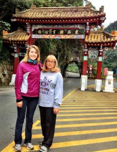 My mom and I are at the entrance to Taroko Gorge National Park in Taiwan