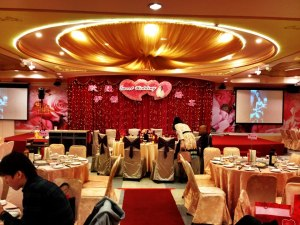 The banquet hall, decorated in red and gold colors for good fortune and wealth