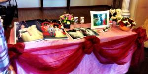 The photo table, complete with picture cards and a book containing dozens of photos of the couple before their big day