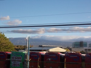 View from a bus out of San Jose of the mountains and the clouds that surround them in the morning.